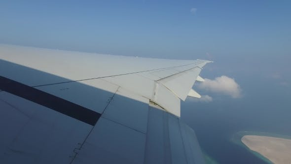 Thumbnail for Wing Of Airplane Flying Above Ocean And Maldives 7
