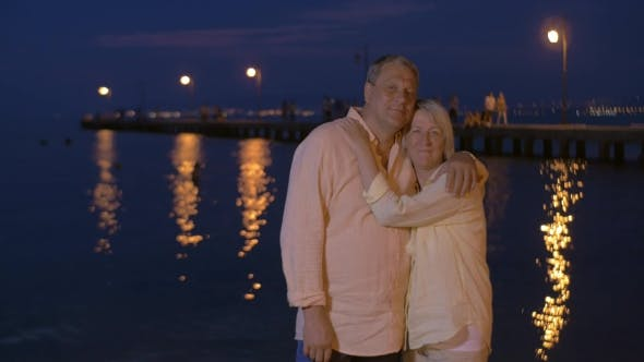 Thumbnail for Loving Senior Couple On Water-front At Night