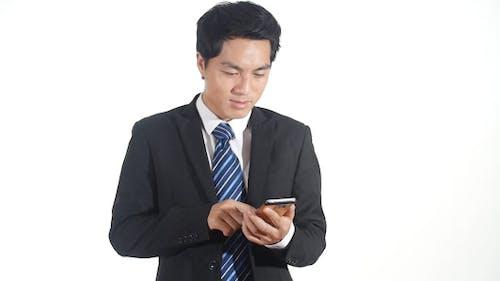 Businessman Sending Messages