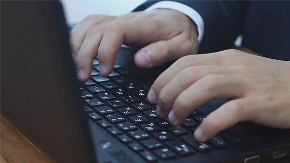 Thumbnail for Man Typing on Laptop Vertical Lift Camera
