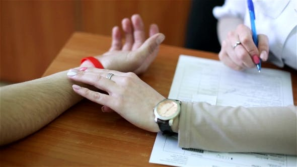 Thumbnail for Heart Rate Measurement: Doctor Measures Pressure To The Patient