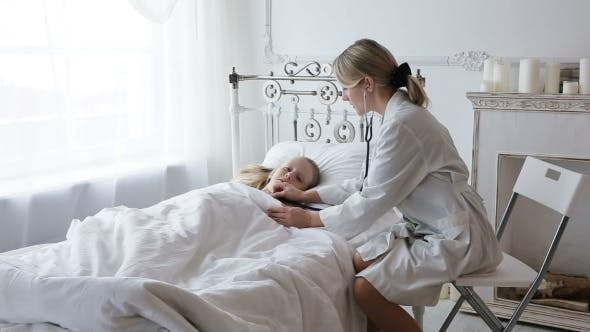 Thumbnail for Doctor Auscultating a Child With a Stethoscope