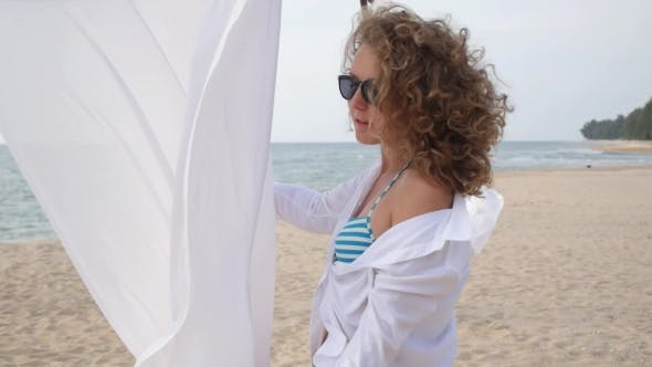 Thumbnail for Sensual Girl On Beach In White Clothing On Vacation