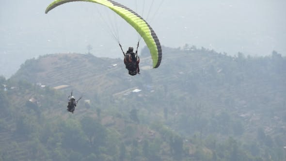 Thumbnail for Paraglider Takeoff And Climb