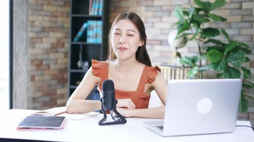 Woman with Mic Recording a Podcast