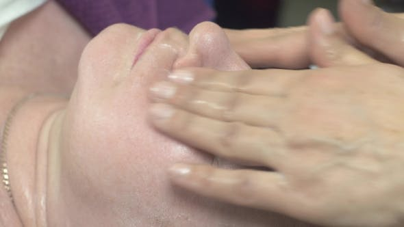 Thumbnail for Cosmetologist Make Massage Face Thick Woman In Beauty Saloon. Stroking. Anti Age