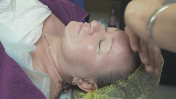 Thumbnail for Cosmetologist Stroke Forehead Of Adult Thick Woman In Beauty Saloon. Anti Aging