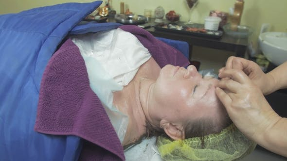 Thumbnail for Cosmetologist Make Massage Of Nose, Forehead To Adult Fat Woman In Beauty Saloon