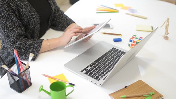 Cover Image for Female Designer Using Tablet, Surfing nad Browsing Online