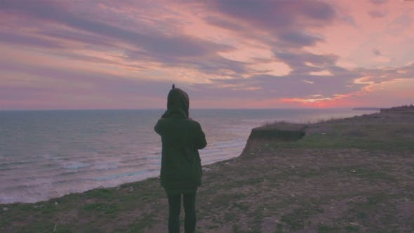 Thumbnail for Young Woman Looking At a Beautiful Sunset
