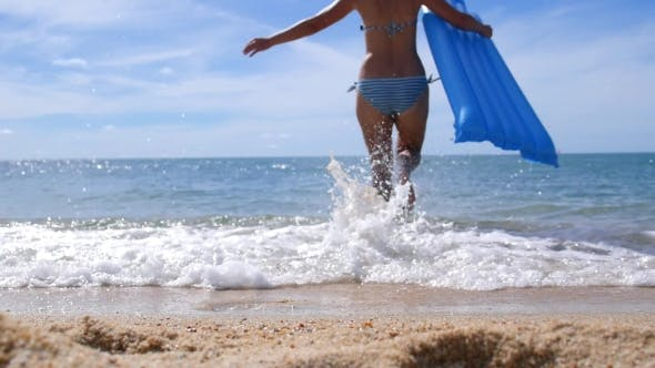 Thumbnail for Woman With Swimming Mattress On Tropical Beach