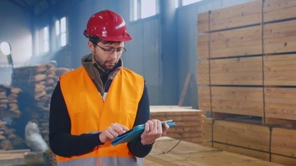 Thumbnail for Warehouse Worker Uses a Tablet