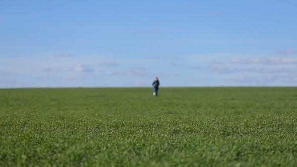 Thumbnail for Girl Runs In The Grass Field
