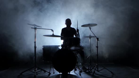 Thumbnail for Energetic Music in the Performance of a Professional Drummer, Black Background, Silhouette