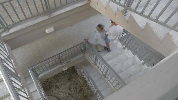 Thumbnail for Couple Walking Down The Spiral Stairs