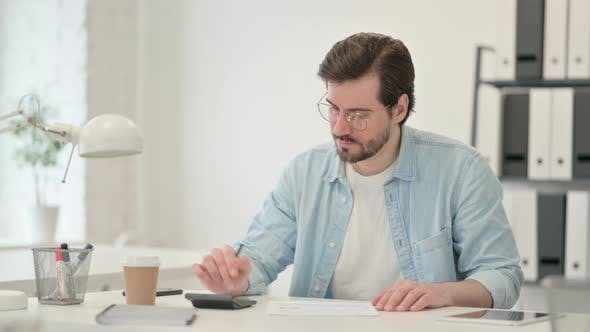 Man Calculator Making Calculations Paper