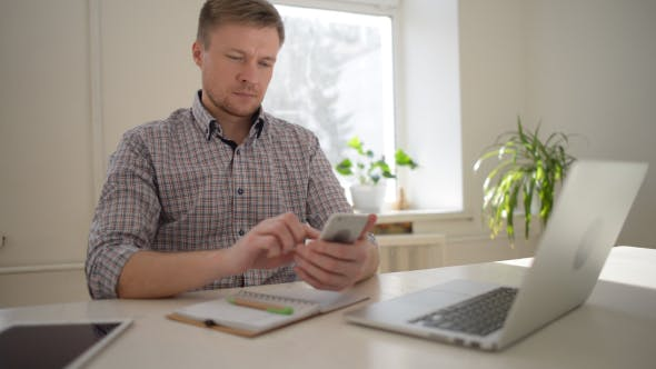 Thumbnail for Freelancer Designer Busy Browsing on Smartphone