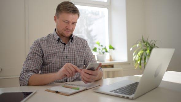 Thumbnail for Freelancer Designer Texting Message on Smartphone