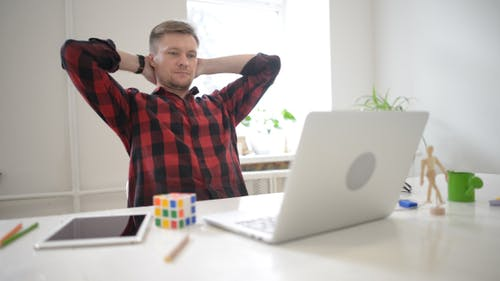 Freelancer Relaxing while Working on Project