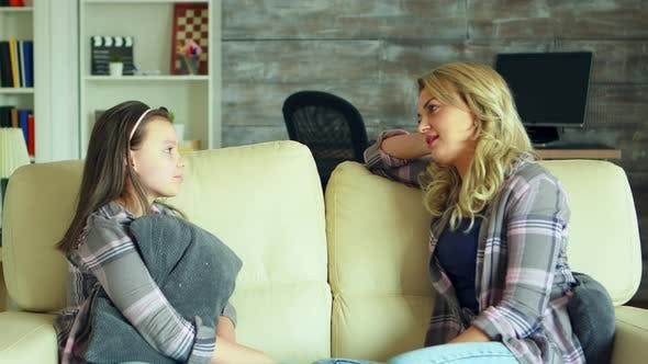 Thumbnail for Preschool Daughter Sitting on the Couch in Living Room