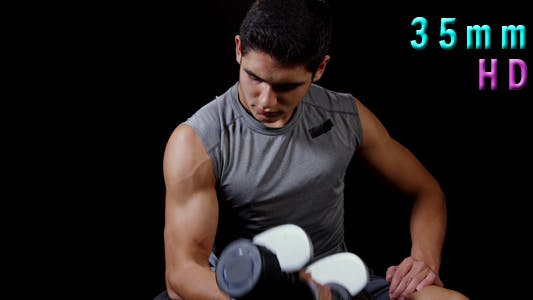 Cover Image for Young Man Doing Curls With Dumbbells
