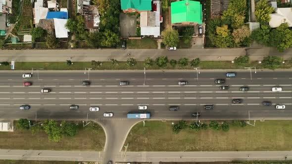 Thumbnail for Modern Highway, Cars Go Fast at Speed, View From a Quadcopter. Traffic Inside the City, High-speed