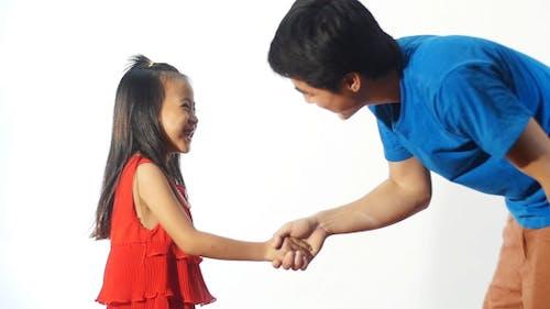 Young Man Handshake With Little Girl