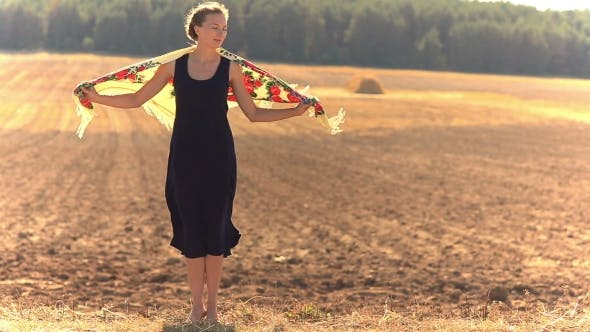 Thumbnail for Girl on a Background of Field in a Strong Wind.