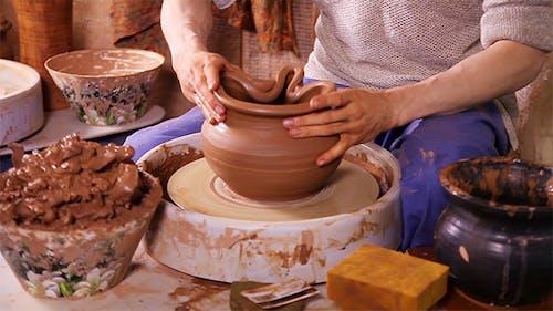 Potter Sculpting a Traditional Clay Pot