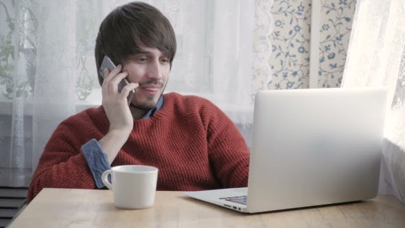 Thumbnail for Happy Young Man Freelancer Working With Modern Laptop And Phone