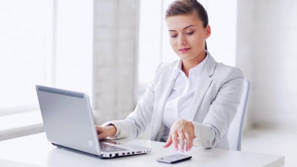 Thumbnail for Woman With Laptop Talking On Smartphone At Office 62