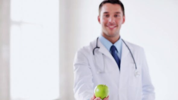 Thumbnail for Happy Doctor Showing Green Apple 50