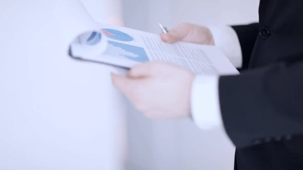Thumbnail for Businessman Hands Checking Documents 11