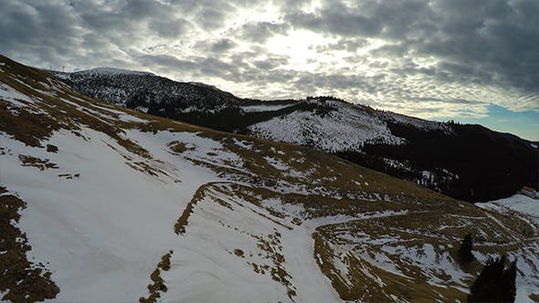 Thumbnail for Flying Over the Mountains in the Winter