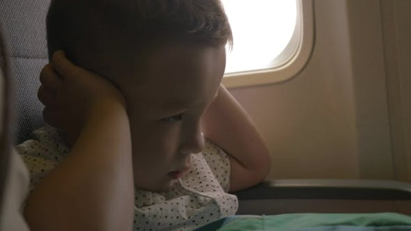 Kid Shutting Ears At The Airplane