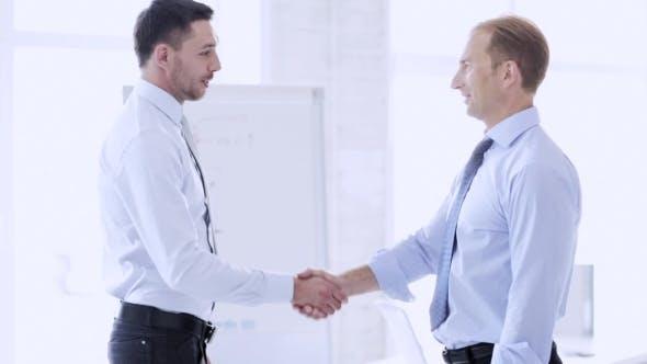 Thumbnail for Happy Businessmen Making Handshake At Office 80