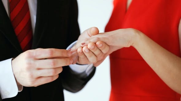 Thumbnail for Groom Putting Engagement Ring To Bride Hand 28