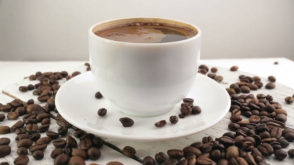 Thumbnail for White Cup With Black, Hot Coffee Standing On Brown, Roasted Beans On Sacking