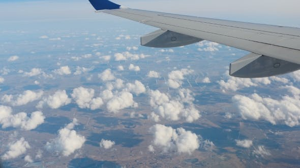 Thumbnail for Clouds Under The Wing Of An Airplane