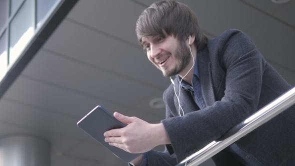 Thumbnail for Man With Tablet PC Chatting, Young Business Man In Airport. Casual Urban Professional Businessman
