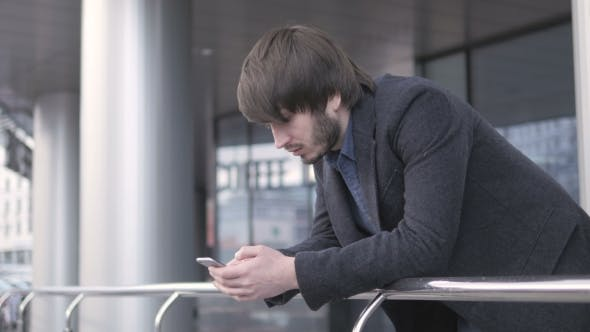 Thumbnail for Freelancer with Smartphone, Young Businessman In Airport.