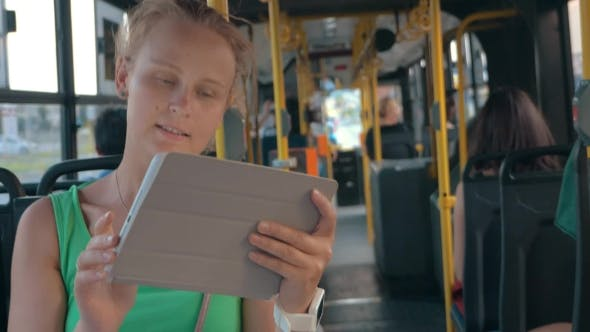 Thumbnail for Smiling Woman With Tablet In Bus