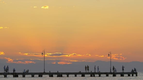 Thumbnail for People Watching Sunset On Pier