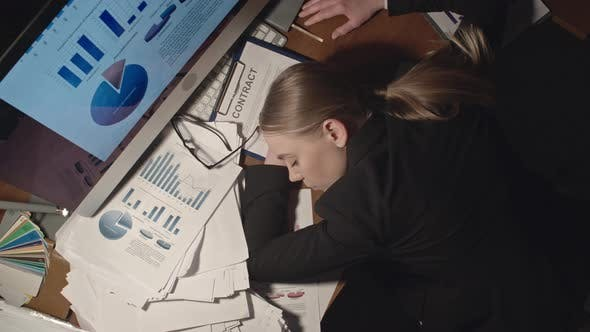 Thumbnail for Female Office Worker Sleeping at Workplace