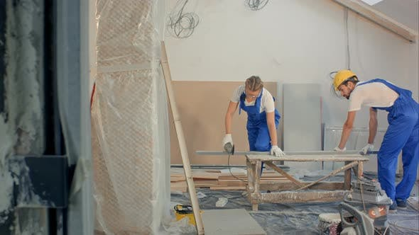 Cover Image for Woman Using Circular Saw Building at Apartment House