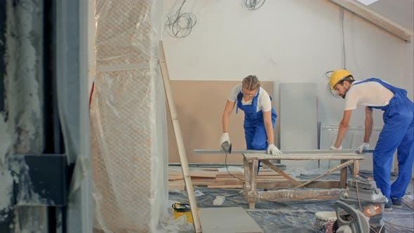 Thumbnail for Woman Using Circular Saw Building at Apartment House