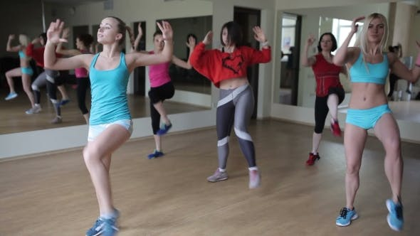 Girls Engaging Aerobics In The Gym
