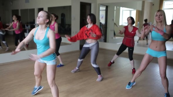Thumbnail for Group Of Women Dancing And Doing Aerobic Exercises