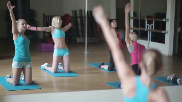 Thumbnail for Girls Perform Stretching Exercises In The Gym