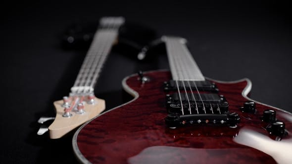 Thumbnail for Red Electric Guitar And Black Bass, Lie Side By Side.